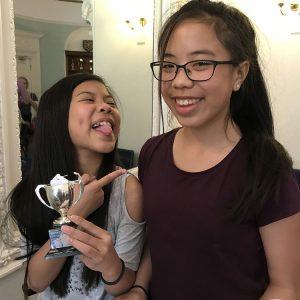 Photo of Sasha & Yasmin Ng with their shared trophy