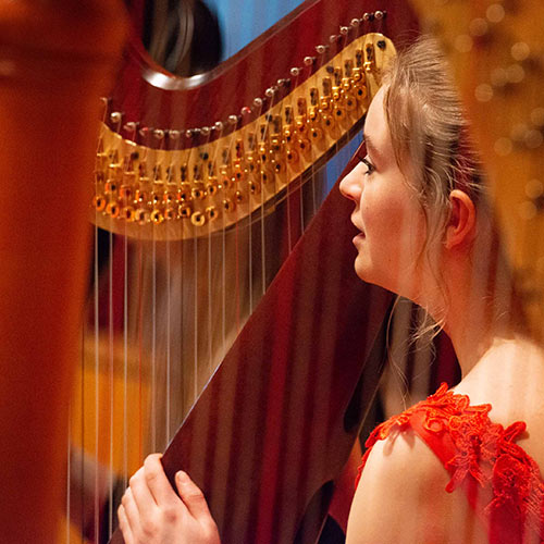 Photo of a young harp player from the NYHO